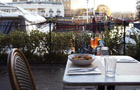 Fresh pasta restaurant St. Katharine Docks with terrace outdoor seating Aperol Spritz Bolognese pasta